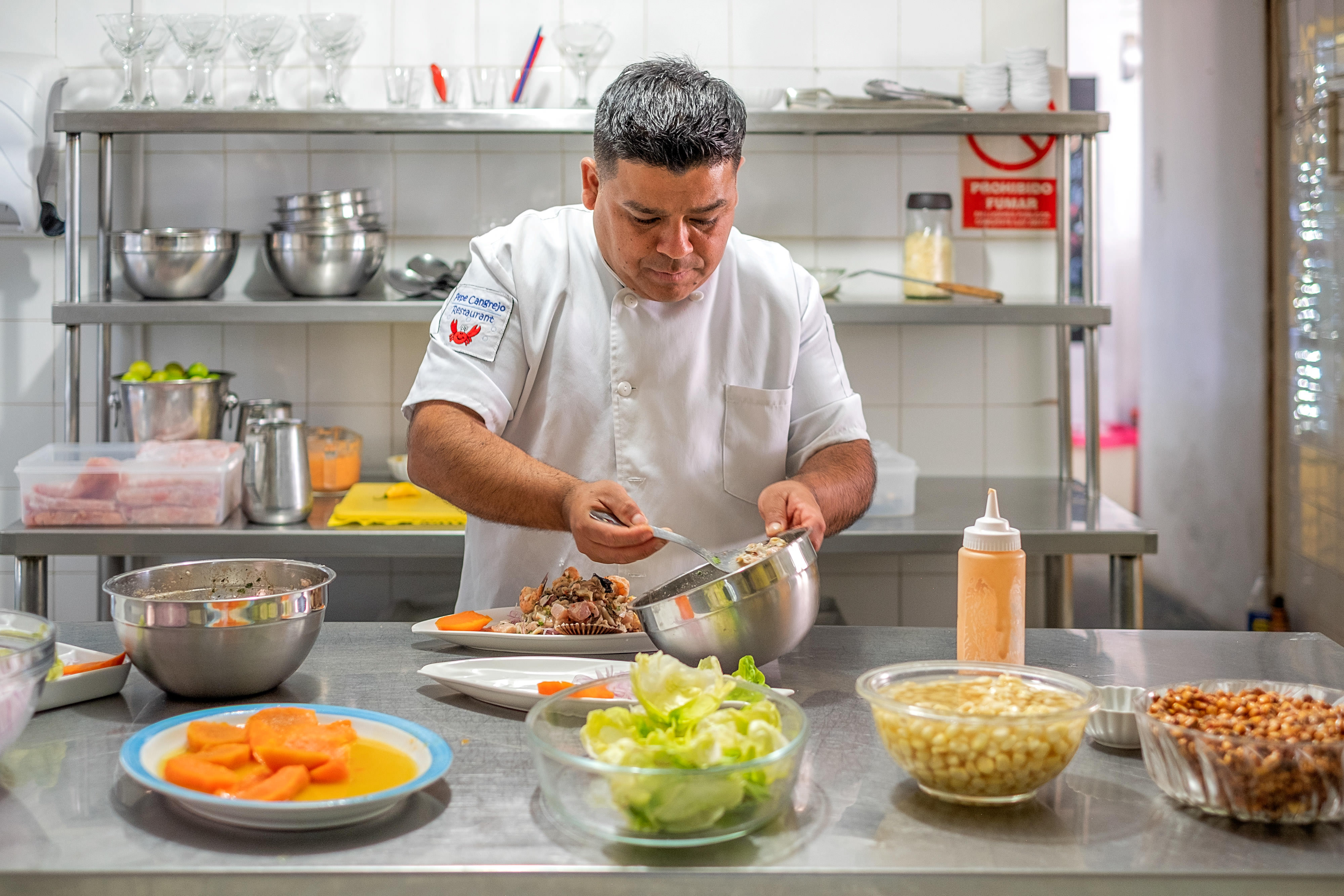 Chef Jose Fernandez owner of Pepe Cangrejo's restaurant, prepares ceviche.