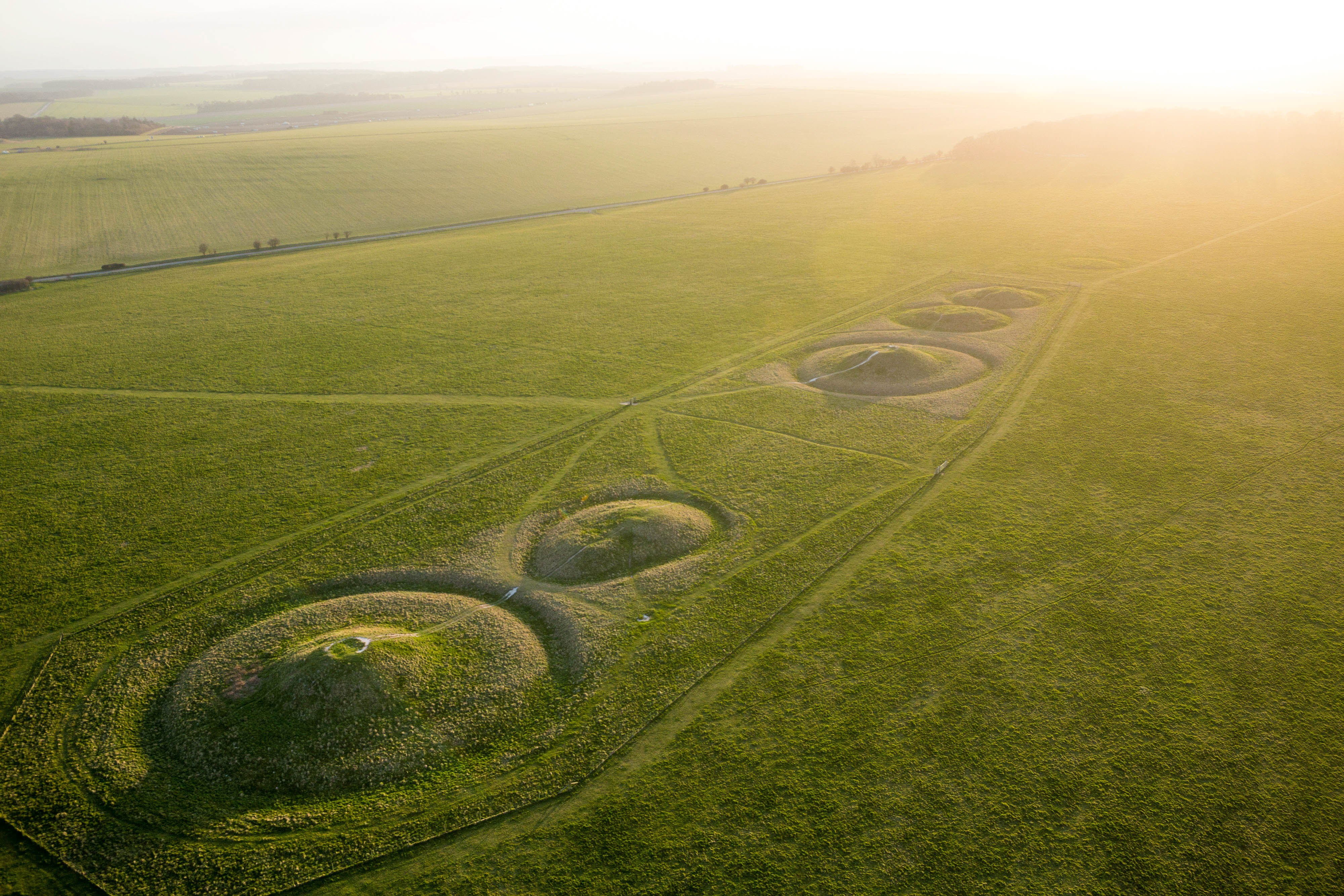Green burial mounds mark the English landscape
